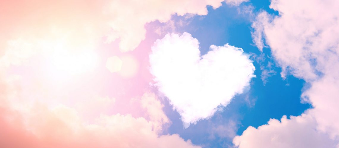 Cloud heart in the sky in the clouds and sunshine